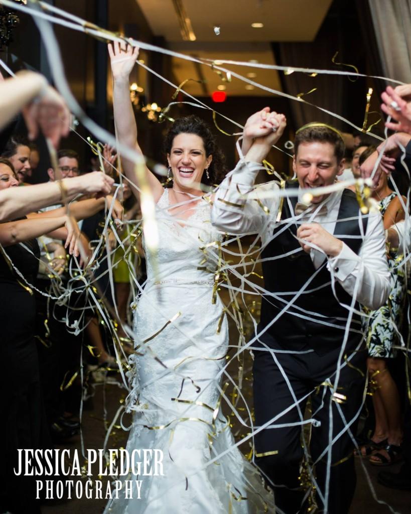Gold Streamers Exit  at Hotel Sorella CITYCENTRE Wedding | Houston Wedding Photographer | Jessica Pledger Photography