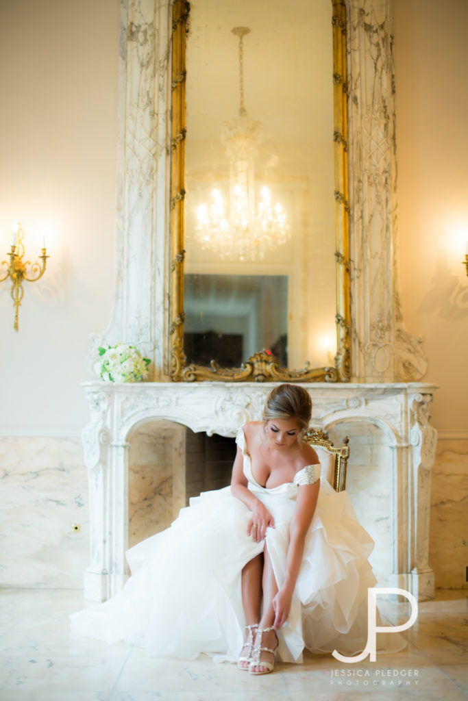 Bride putting on shoes at Chateau Cocomar