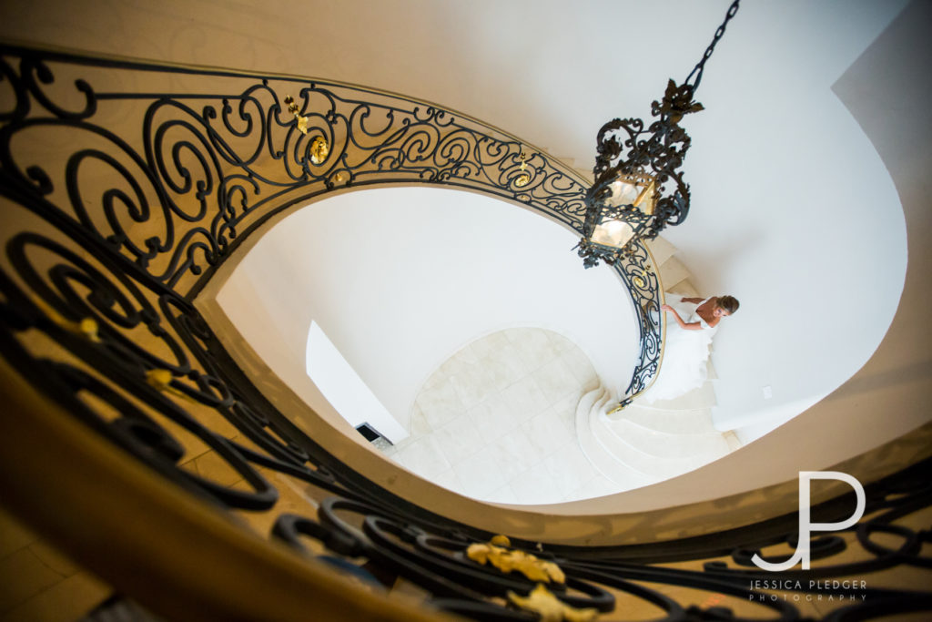 Bride on stairway at Chateau Cocomar