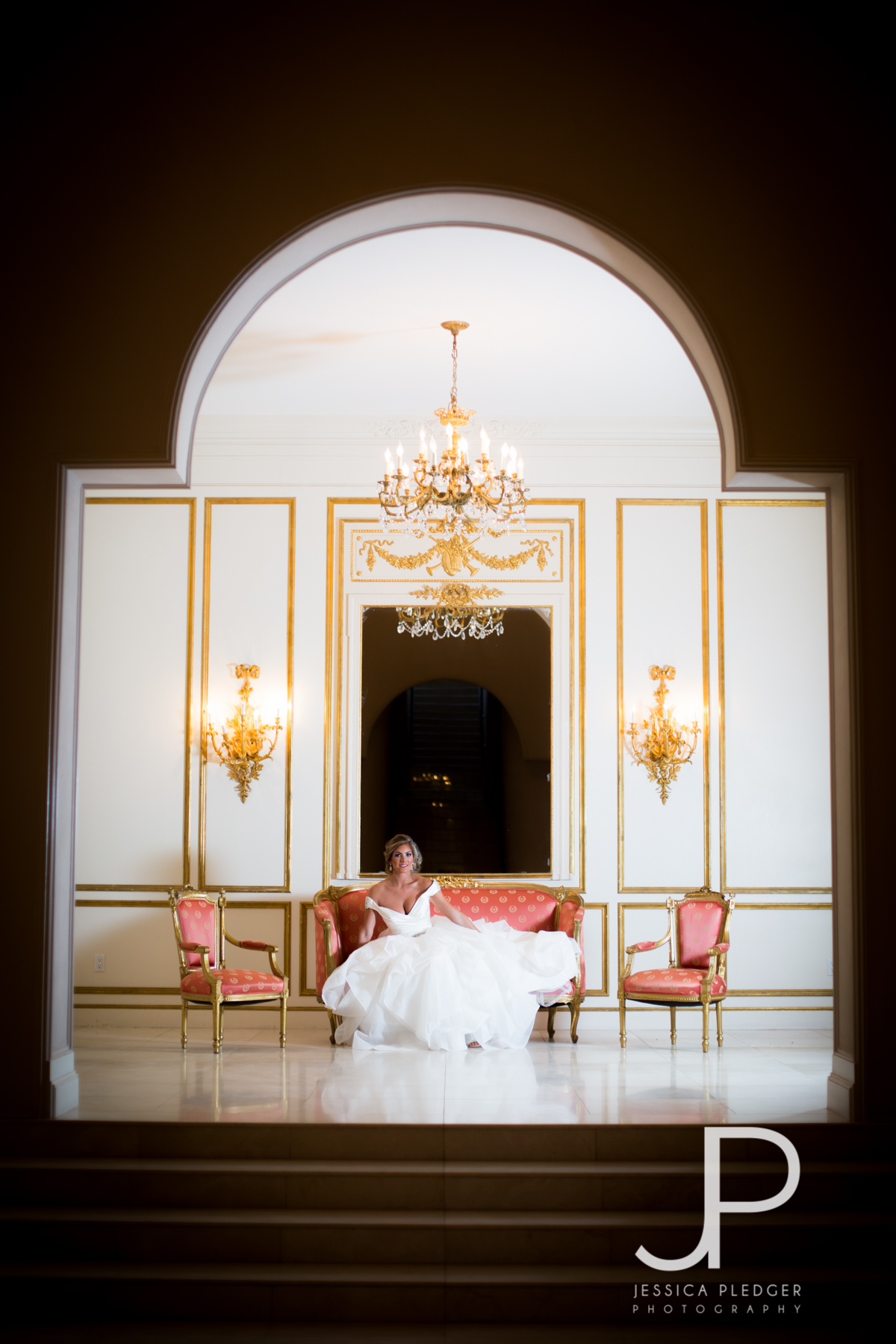 Bride on Couch at Chateau Cocomar