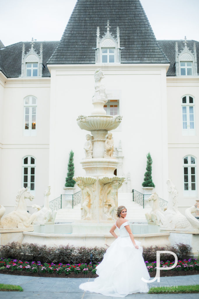 Bride in front of fountain at Chateau Cocomar