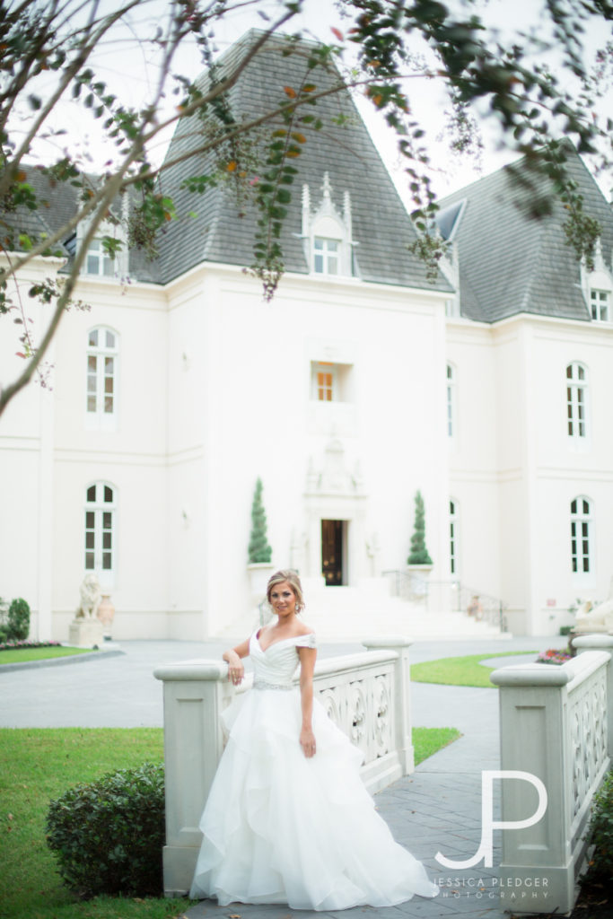 Bride on bridge at Chateau Cocomar
