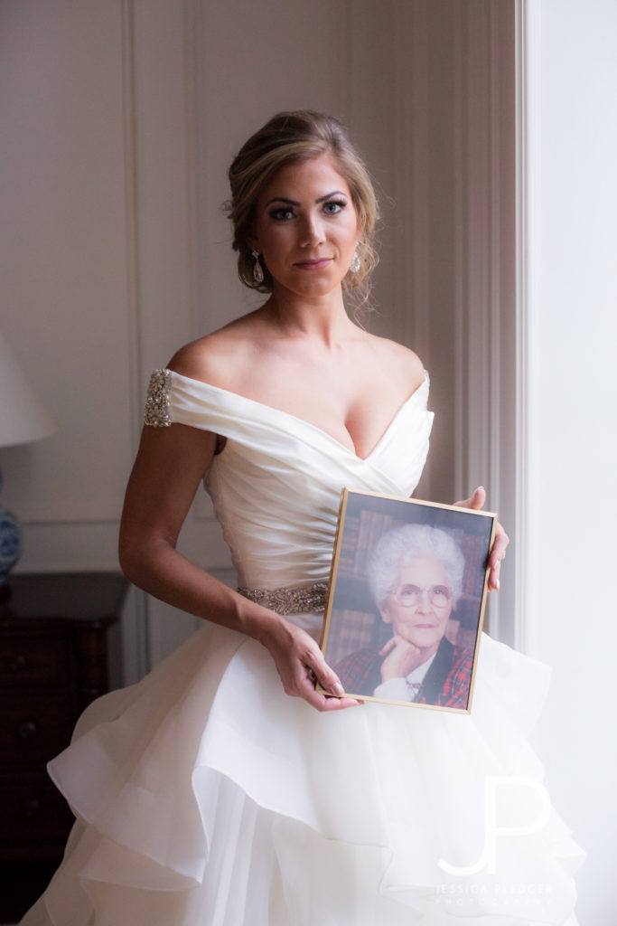 Bride holding grandmother's photo