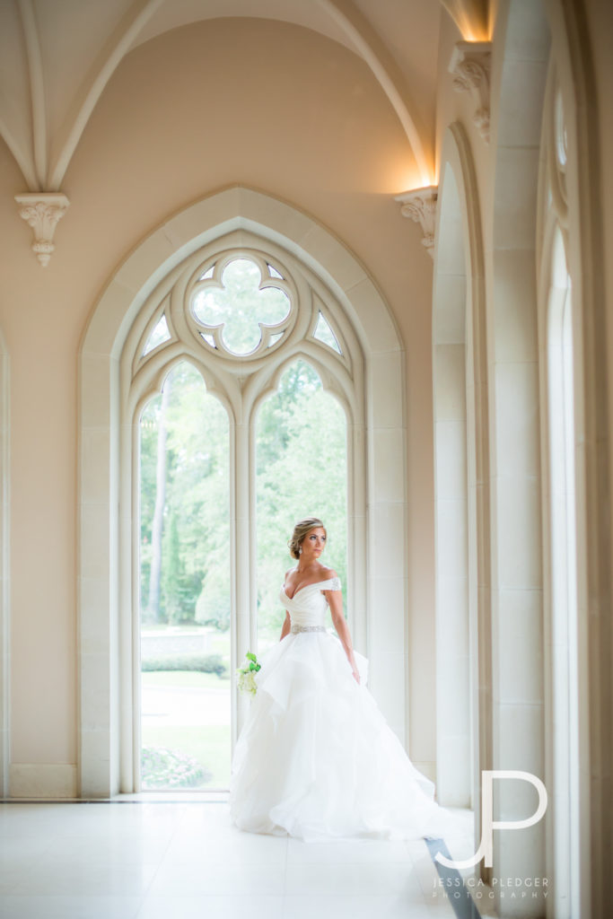 Bride looking out window at Chateau Cocomar
